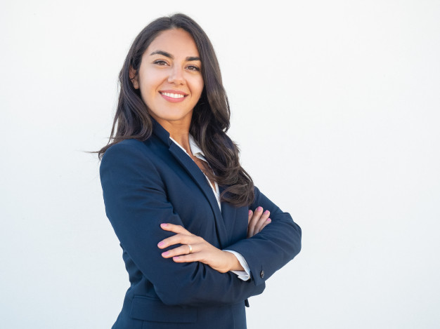 smiling-confident-businesswoman-posing-with-arms-folded_1262-20950